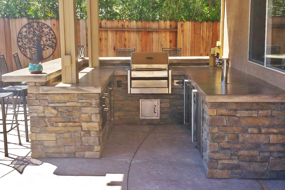 Custom outdoor kitchen with seating bar, custom kegerator