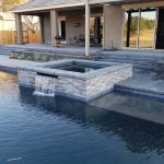 Modern Ledge Stone Outdoor Kitchen, Fire Pit, and Poolside Deck build in Plymouth