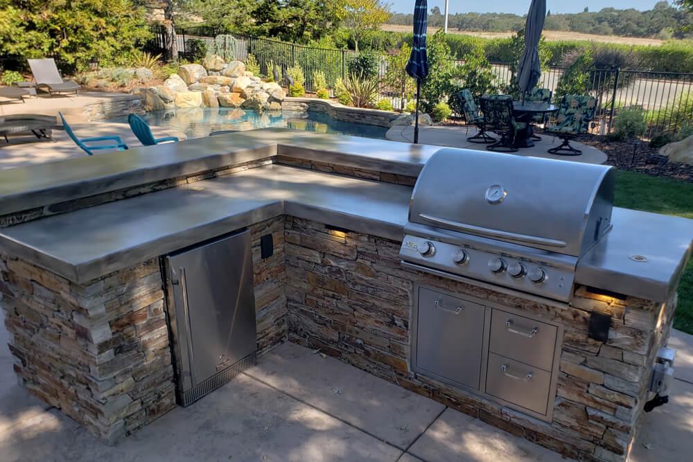Natural Ledge Stone Outdoor Kitchen Designed to Entertain in Rancho Murrieta